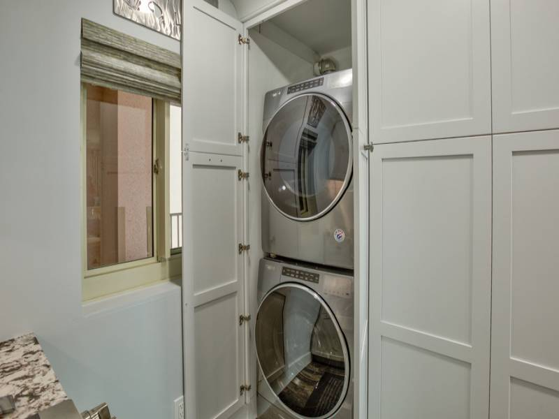 This unit is complete with a washer and dryer for your convenience