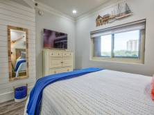 Enjoy the nautical theme continuing into the guest bedroom